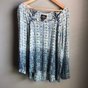 Shades of blue long sleeved blouse with hi-lo hem